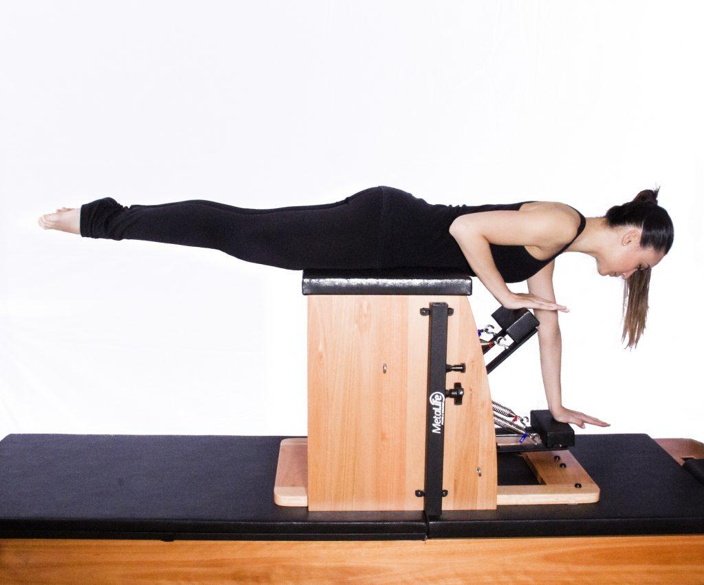 Exercício de pilates chair